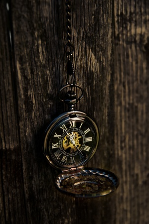 gold watch: Time - Vintage Pocket Watch on Weathered Wood Background