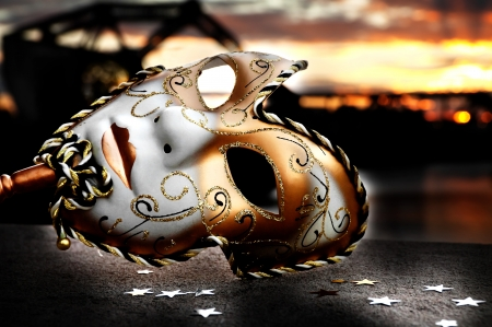 mardi gras: Venetian Mask by the River Bridge with Sunset Stock Photo