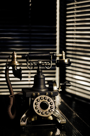 Vintage Telephone - Film Noir Scene with Retro Phone and Blinds photo
