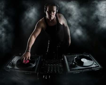 dancing club: Dark Beats - DJ Mixing Stock Photo