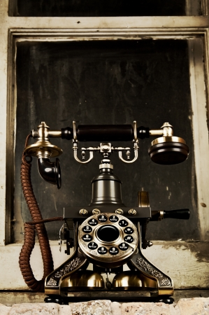 contact center: Retro Phone - Vintage Telephone by Old Grunge Window Stock Photo