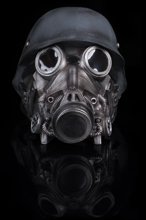 Military Helmet with Goggles and Gas Mask isolated on Black Background