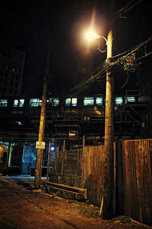 Dark City Alley at Night with Train Stock Photo