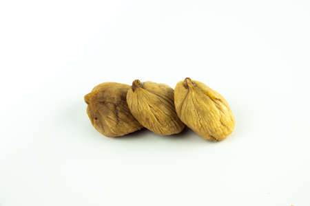 Dried figs fruit isolated on white background.