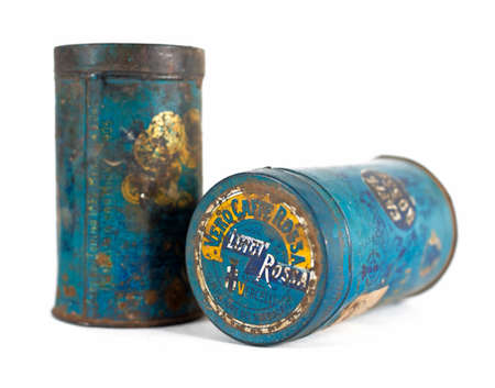 gold cans: Two old and rusty coffee cans early 900 - with clipping path Stock Photo