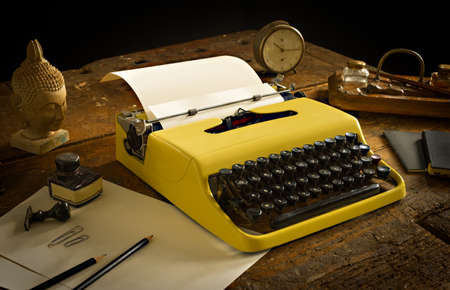 wooden desk: Vintage typewriter above an old wooden desk