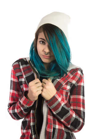 plaid shirt: Beautiful hipster girl looking fearfully at camera on white background. Pierced, turquoise haired and dressing up a plaid shirt. Stock Photo