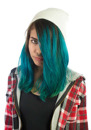 plaid shirt: Beautiful hipster girl looking seriously at camera on white background. Pierced, turquoise haired and dressing up a plaid shirt. Stock Photo