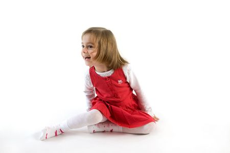 Smiling little girl wearing red dress