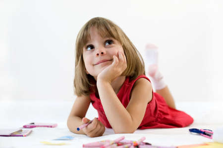 Little girl looking for a drawing concept Stock Photo