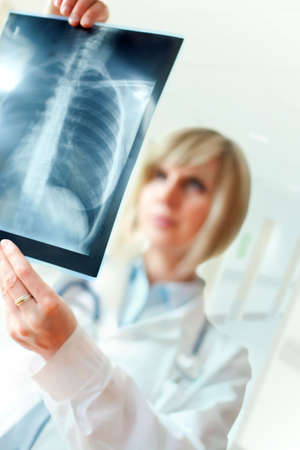 Female doctor examing an x-ray Stock Photo