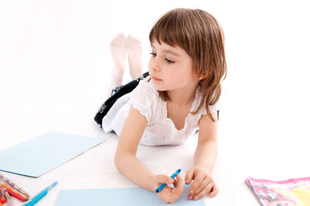 Llittle girl with a crayon, draws a picture . Stock Photo