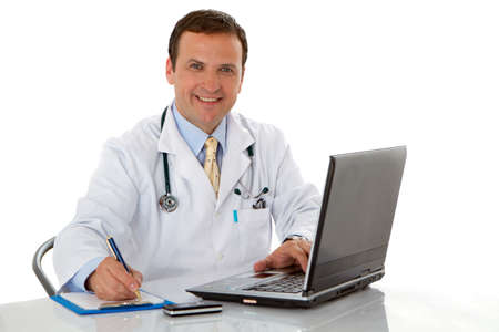 Male doctor write medical reports - at work use laptop photo
