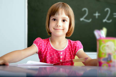 Portrait of a young pupil in a classroom  Stock Photo