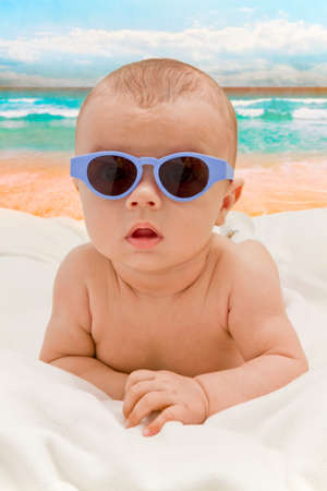 funny baby: Funny baby in sunglasses on the beach