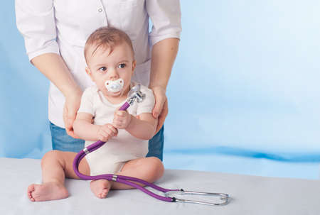 Doctor and baby patient  Stock Photo