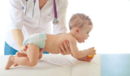 Pediatrician examining baby - doctor and patient photo
