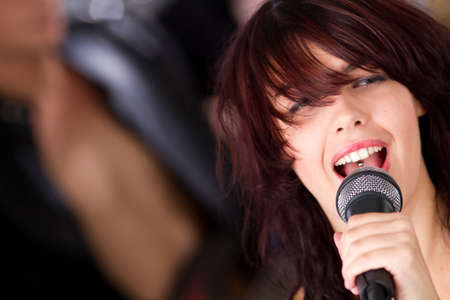 rock singer: Female rock singer with microphone in hand