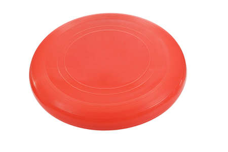 flying disc: Red flying disc. Stock Photo