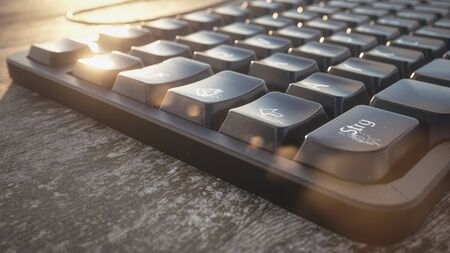 pc keyboard on a table with worn natural wood - 3D Rendering