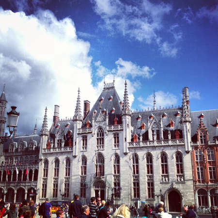 assume: The Provinciaal Hof Provincial Court was formerly the seat of the West Flanders Provincial Council. Visitors to Bruges often assume that the Gothic-style edifice is one of the citys many medieval buildings but its construction did not begin until 1887. Stock Photo
