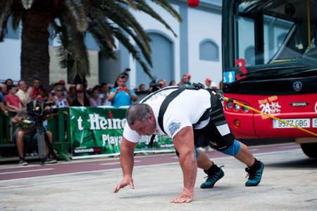 CANARY ISLANDS – SEPTEMBER 03: Juan Carlos Heredia from Spain pulling a double-decker bus behind himself during Strongman Champions League in Las Palmas September 03, 2011 in Canary Islands, Spain Stock Photo - 10515412