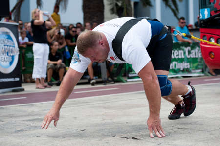 CANARY ISLANDS – SEPTEMBER 03: Lauri Nami from Estonia pulling a double-decker bus behind himself during Strongman Champions League in Las Palmas September 03, 2011 in Canary Islands, Spain