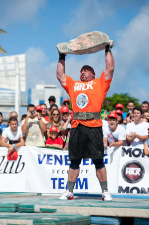 CANARY ISLANDS – SEPTEMBER 03: Ervin Katona from Serbia lifting a heavy stone during Strongman Champions League in Las Palmas September 03, 2011 in Canary Islands, Spain