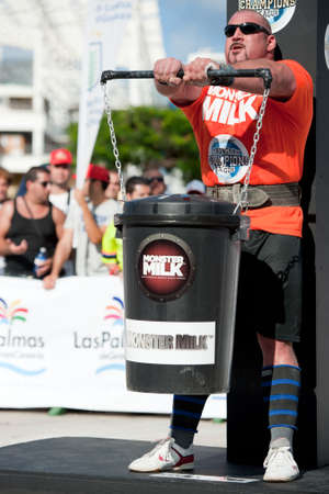 CANARY ISLANDS - SEPTEMBER 03: Ervin Katona from Serbia lifting a heavy trash can for longest possible time during Strongman Champions League in Las Palmas September 03, 2011 in Canary Islands, Spain  Stock Photo - 10559047