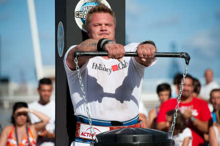 CANARY ISLANDS - SEPTEMBER 03: Tomi Lotta from Finland  lifting a heavy trash can for longest possible time during Strongman Champions League in Las Palmas September 03, 2011 in Canary Islands, Spain  Stock Photo - 10559045