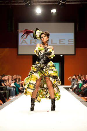 CANARY ISLANDS - 29 OCTOBER: Model on the catwalk wearing carnival costume from designer Julio Vicente Artiles during Carnival Fashion Week October 29, 2011 in Canary Islands, Spain