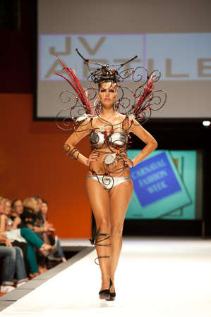 CANARY ISLANDS - 29 OCTOBER: Model on the catwalk wearing carnival costume from designer Julio Vicente Artiles during Carnival Fashion Week October 29, 2011 in Canary Islands, Spain Editorial