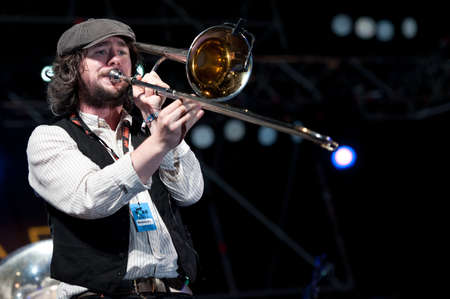 CANARY ISLANDS - NOVEMBER 12: Matthew Benson from Ireland playing trombone onstage with Brassroots during Womad 2011 November 12, 2011 in Las Palmas, Canary islands, Spain Editorial