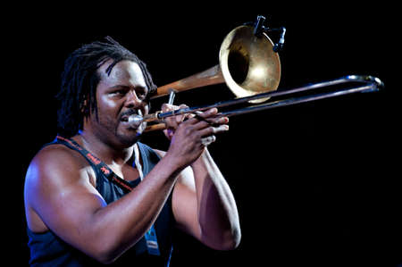 CANARY ISLANDS - NOVEMBER 12: Bandleader of Brassroots Jerome Harper, from US, playing trombone onstage during Womad 2011 November 12, 2011 in Las Palmas, Canary islands, Spain Editorial