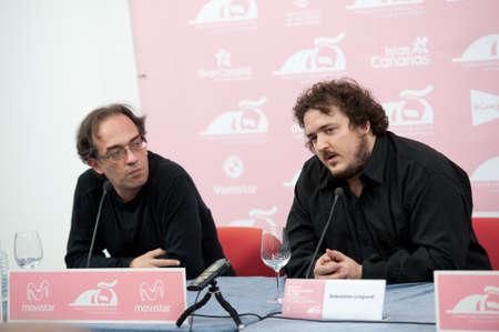 cinematographer: LAS PALMAS, SPAIN-MARCH 16: Scheduling coordinator Luis Miranda Sebastian(l) and Sebastian Lingiardi(r), during LPA International Film Festival on March 16, 2012 in Las Palmas, Spain