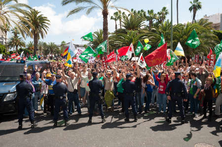 LAS PALMAS, SPAIN-MARCH 29: Unidentified workers protesting against new labor reforms and austerity cuts, during the Spanish general strike 29-M on March 29, 2012 in Las Palmas, Spain Stock Photo - 12925628