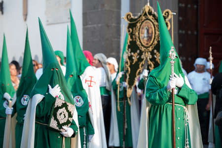LAS PALMAS, SPAIN-APRIL 2: Unidentified persons, from Canary Islands, wearing hoods (capirotes) and cloaks, during Holy Week marching procession on April 2, 2012 in Las Palmas, Spain
