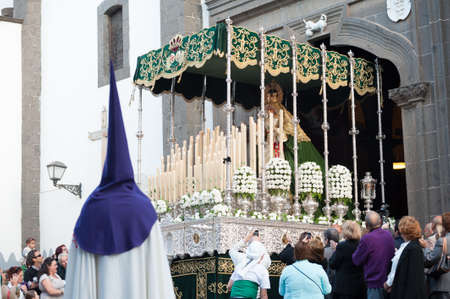 LAS PALMAS, SPAIN-APRIL 2: Unidentified persons, from Canary Islands, celebrating the float of Virgin Mary, during Palm Sunday marching procession on April 2, 2012 in Las Palmas, Spain