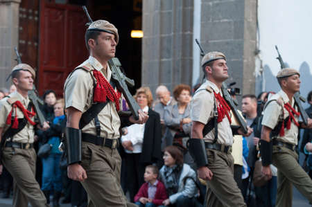 LAS PALMAS, SPAIN-APRIL 2: Unidentified soldiers, from the Spanish Legion, marching, during Palm Sunday marching procession on April 2, 2012 in Las Palmas, Spain