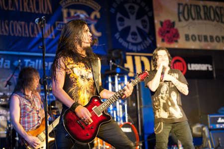 CANARY ISLANDS, SPAIN-MAI 5: Guitarist Alberto Marin(m), Alvaro Tenorio(l) and J. Molly (r) from Hamlet, from Madrid, perform during Harley Davidson MCs celebration on Mai 5, 2012 in Canary Islands, Spain Stock Photo - 13575983