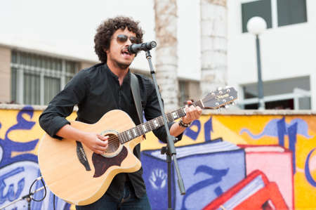 onstage: LAS PALMAS, SPAIN-APRIL 13: Singer and guitarist Said Muti, from Canary Islands, perform onstage during a charity for Sahara on April 13, 2012 in Las Palmas, Spain