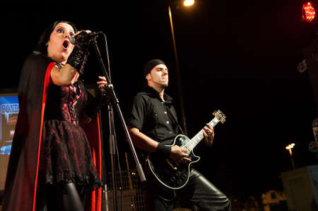 onstage: CANARY ISLANDS-SPAIN MAY 18: Maria del Carmen Ortiz (l) and Jakob Ramirez(r) in Fallen Hall, perform onstage during Condenados Rock on May 18, 2012 in Canary Islands, Spain