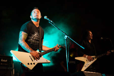 CANARY ISLANDS, SPAIN-JUNE 30: Brigido Duque(l) and Rafael Redin(r) from the band Koma, from Navarra in Spain, perform during Cebollinazo Rock in Galdar on June 30, 2012 in Canary Islands, Spain