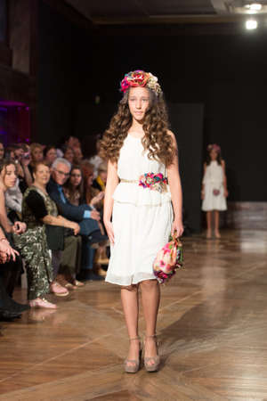 LAS PALMAS, SPAIN - MARCH 12, 2015: A child model walks the runway wearing a wedding dress from designer Nieves Barroso during Gran Canaria Moda Calida 2016 Bridal Collection at Museo Nestor.
