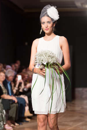 LAS PALMAS, SPAIN - MARCH 12, 2015: A model walks the runway wearing a wedding dress from designer Nieves Barroso during Gran Canaria Moda Calida 2016 Bridal Collection at Museo Nestor.