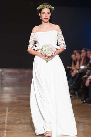 LAS PALMAS, SPAIN-MARCH 13, 2015: A model walks the runway wearing a wedding dress from designer Elena Rubio during Gran Canaria Moda Calida 2016 Bridal Collection at Museum Nestor. Editorial