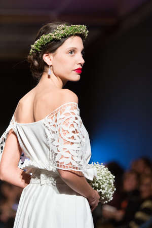 LAS PALMAS, SPAIN-MARCH 13, 2015: Laura Medina walks the runway wearing a wedding dress from designer Elena Rubio during Gran Canaria Moda Calida 2016 Bridal Collection at Museum Nestor. Editorial