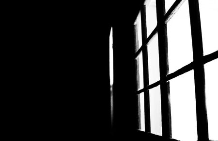A black and white image of light coming from a window