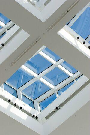 Skylight windows with a blue sky behind them Stock Photo