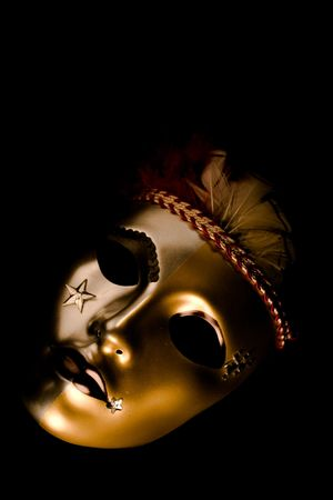 red glittery: A venetian mask decorated with feathers and stars isolated against a black background Stock Photo